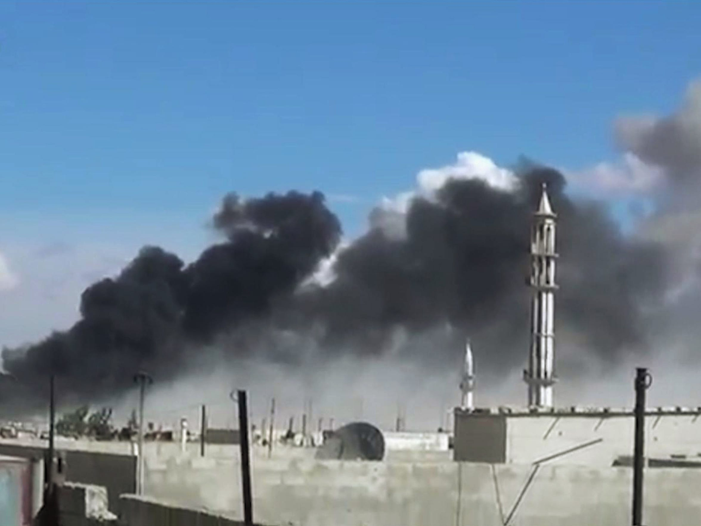 Smoke rises over Talbiseh, a city in western Syria's