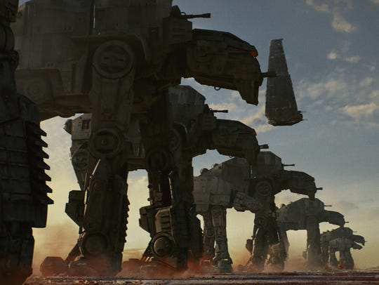 """The First Order's AT-M6 Walkers walk along planet Crait in """"Star Wars: The Last Jedi."""""""