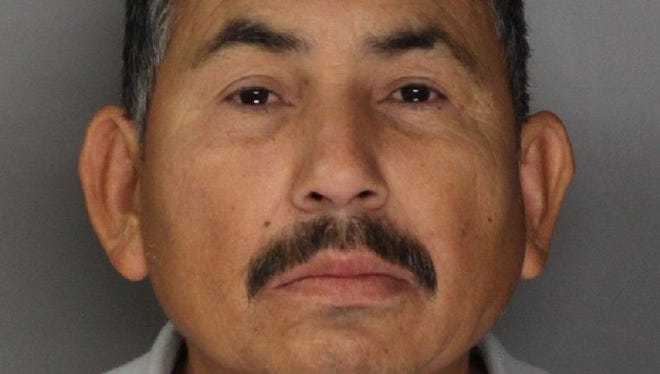 In this handout photo released by the Sacramento County Sheriff's Department is  Genaro Olaguez, who was arrested and sent back to Mexico on allegations that he killed eight government officials in Mexico.