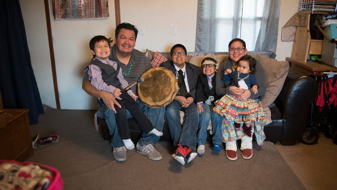 The Bennallie family at home in Fort Defiance, Arizona, on the Navajo Nation. From left, Bryson, 6; Evans; Tyler, 11; Conner, 4; Amanda; and Emily, 1.