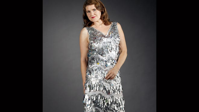 """Upcycle artist Nancy Morris-Judd models her """"Aluminum Drop Dress,"""" which features teardrops and circles hand-cut from aluminum cans. The 1920s retro flapper dress was sewn from a used cloth shower curtain. The shoe and dress combo took 200 hours to make. Judd will emcee Upcycle Oregon from noon to 4 p.m. on Saturday, April 11, at the Oregon State Capitol."""