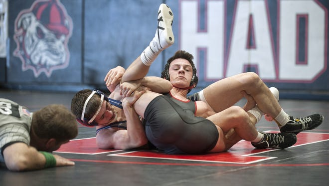 Collingswood's Joe Tenuto, left, locks Haddonfield's Evan Finnegan in a spladle during their 120-pound bout on Wednesday. Tenuto earned a controversial fall in the Panthers' 41-12 victory.