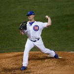 Chicago Cubs relief pitcher Clayton Richard (33) pitches the fourth inning against the New York Mets in game four of the NLCS at Wrigley Field.