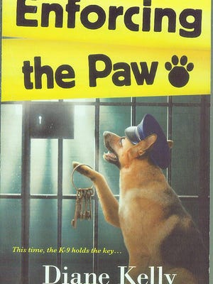 """""""Enforcing the Paw"""" by Diane Kelly"""