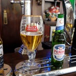 AB InBev's brands include Budweiser, Stella Artois and Corona, while SABMiller produces Peroni and Grolsch