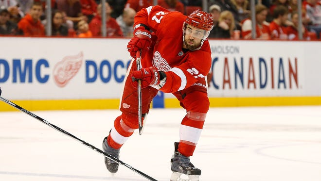 Detroit Red Wings defenseman Kyle Quincey shoots against the Buffalo Sabres on Dec. 23, 2014.