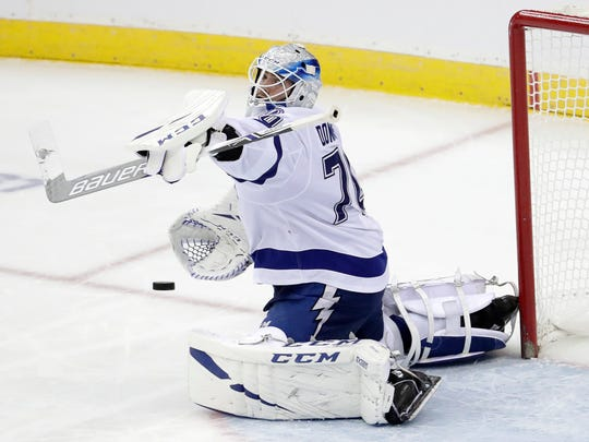 Tampa Bay Lightning goaltender Louis Domingue makes a save against the New Jersey Devils during the third period of an NHL hockey game, Monday, Dec. 3, 2018, in Newark, N.J. The Lightning won 5-1. (AP Photo/Julio Cortez)