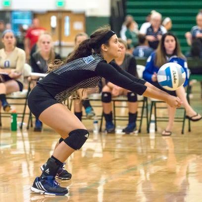 Jess Cadena of Harper Creek returns a serve Saturday