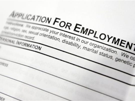 FILE - This April 22, 2014, file photo shows an employment application form on a table during a job fair at Columbia-Greene Community College in Hudson, N.Y. The Labor Department releases its weekly report on applications for unemployment benefits on Thursday, Sept. 25, 2014. (AP Photo/Mike Groll, File)