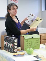 Jennifer Guinta-Hausler, co-founder of the Nyack Seed Exchange, gives a lecture at the Nyack Public Library on Saturday, September 23, 2017.