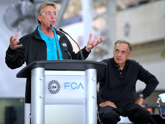 "Former United Auto Workers Vice President Norwood Jewell, left, with the late Fiat Chrysler CEO Sergio Marchionne, is among ""lots of individuals and entities"" under criminal investigation by the federal government, a prosecutor said Friday."