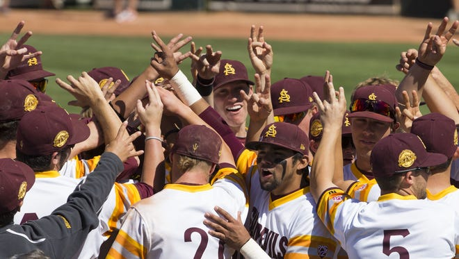 Arizona State baseball players celebrate their 8-6 win over Oregon in a Pac-12 conference game at Packard Stadium on  May 11, 2014.