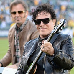 Journey guitarist Neal Schon, right, and keyboardist Jonathan Cain perform at O.co Coliseum in Oakland, Calif., in May 2014. The band is hitting the road next summer with The Doobie Brothers and Dave Mason.