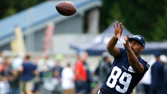 Seattle Seahawks wide receiver Doug Baldwin makes a catch during NFL football training camp, Saturday, Aug. 6, 2016, in Renton, Wash.