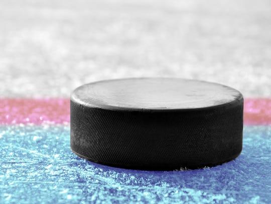 Hockey puck on ice rink