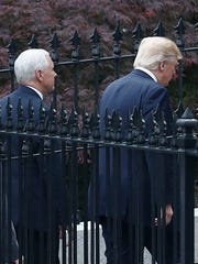President Donald Trump, right, and Vice President Mike Pence walk Wednesday to the Eisenhower Executive Office Building on the White House complex.