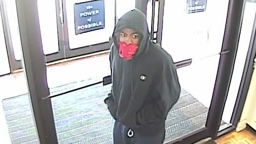 Surveillance footage showing a suspect wanted in connection to a bank robbery Friday in Queensgate.