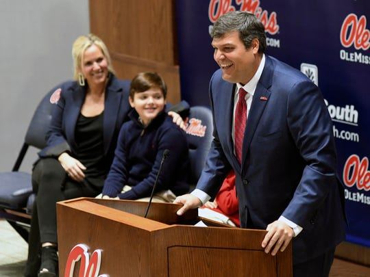 Matt Luke speaks after being introduced as the new NCAA college football head coach at the University of Mississippi during a press conference in Oxford, Miss., Monday, Nov. 27, 2017. At left looking on are Luke's wife Ashley and sons Harrison and Cooper, obscured behind his father. (Bruce Newman, Oxford Eagle via AP)