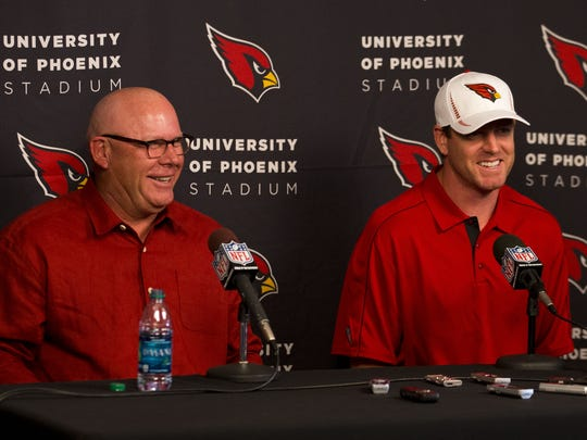 Bruce Arians introduces Carson Palmer after the Cardinals traded for the quarterback during a press conference in Tempe in 2013.
