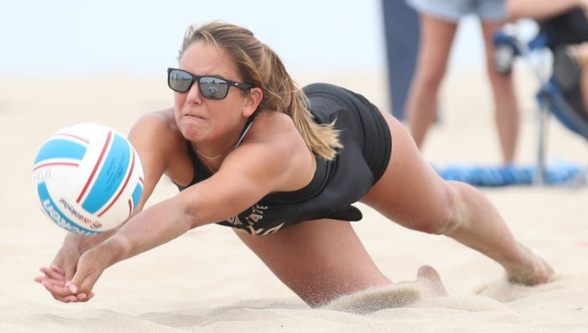 Florida State's Katie Horton, a 2013 Wayne Memorial High grad, dives for the dig in beach volleyball match.