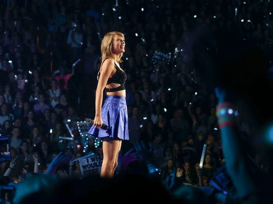 Performing artist Taylor Swift performs to a sold out crowd at Wells Fargo Arena in Des Moines on Thursday, Oct. 8, 2015.