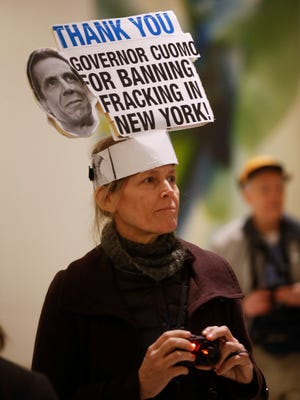 Leslie Roeder of New York City wears a sign on her head before Gov. Andrew Cuomo's State of the State address and executive budget proposal at the Empire State Plaza Convention Center on Wednesday, Jan. 21, 2015.