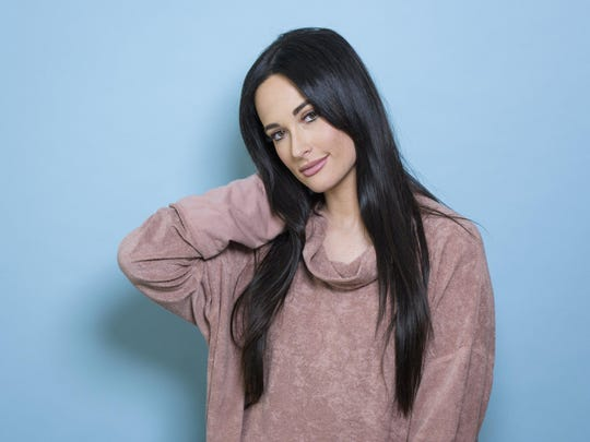 """Kacey Musgraves poses on March 28, 2018, for a portrait in New York to promote her third album, """"Golden Hour."""" Musgraves is nominated for several Grammy Awards, including album of the year and best country solo performance."""