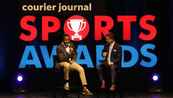 Former University of Louisville and current New York Jets' quarterback Teddy Bridgewater talks with Jeff Greer at the Courier Journal Sports Awards Thursday night at the Louisville Palace.
