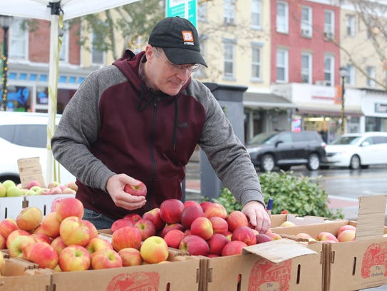 Mark Mills of Nyack selects some apples at the Nyack Farmers' Market.