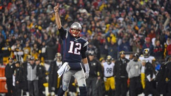 New England Patriots quarterback Tom Brady (12) celebrates after a touchdown during the third quarter against the Pittsburgh Steelers in the 2017 AFC Championship Game at Gillette Stadium.