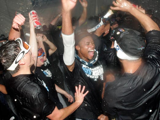 Members of the Tampa Bay Rays celebrate in the clubhouse after defeating the Texas Rangers 5-2 at Rangers Ballpark at Arlington.