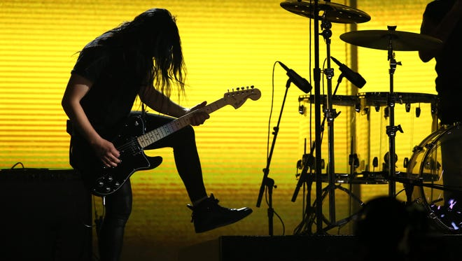 Skrillex, seen playing guitar at this year's Grammy Awards ceremony, will perform on May 29 at Indianapolis Motor Speedway.