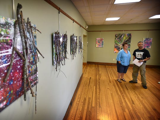 Visitors to the Lebanon Valley Council on the Arts Barb and Luther Tyree walk through an exhibit by local artist Candy Sparks on Friday, July 1, 2016. The art show was in conjunction with the First Friday Art Walk. The Council on the Arts in Lebanon featured work by Gary Shiner, Steve Wetzel, Candy Sparks and Jerome Wright.