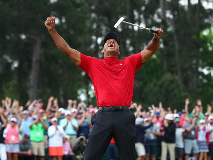 Tiger Woods celebrates after making a putt on the 18th green to win The Masters at Augusta National Golf Club. Photo: Rob Schumacher-USA TODAY Sports