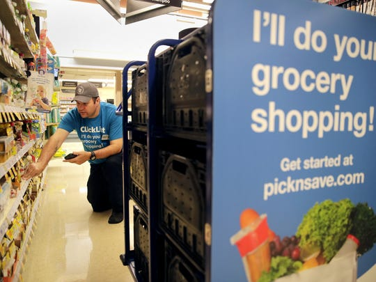 Patrick Hanley, an employee at Pick 'n Save, fills a grocery order from ClickList.