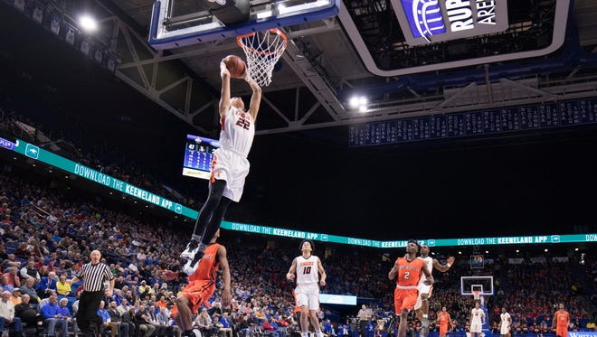 Fern Creek's Chance Moore (22) dunks the ball during the first round game of the KHSAA Boy's Sweet Sixteen against Hopkinsville.
