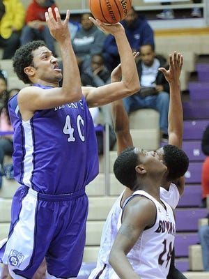 Brennan Gillis scores in the lane for BD. Ben Davis defeated Bowman Academy 81-71 at Ben Davis Friday January 3, 2014.