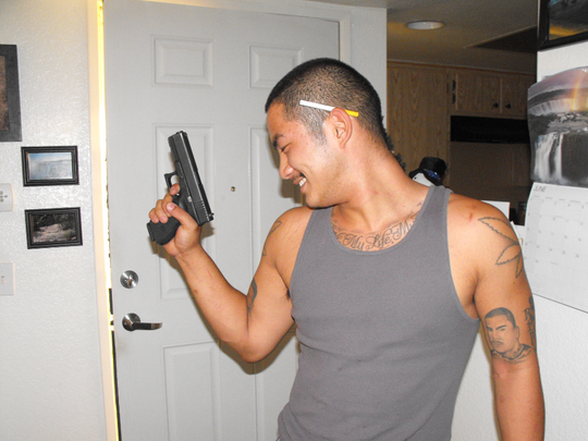 Neighbor LaVerne Paananen said suspect Sean Bajarano asked her to take a photo of him with a gun a few weeks ago.