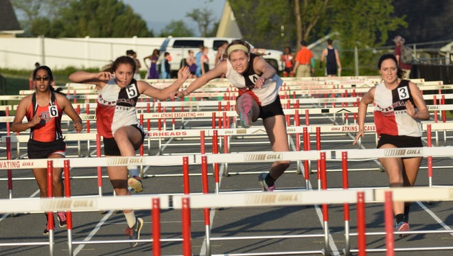 Riverheads' Madison Miller, center, leads teammates Cecelia Burch, left, and Shelby Smiley, right, on the way to winning the girls 100-meter hurdles during the Augusta County Invitational track and field meet at Riverheads High School on Friday, April 28, 2017.