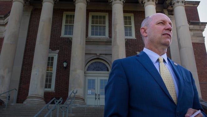 Principal Jeffrey Brokamp stands in front of Walnut Hills High School Tuesday, May 16, 2017.