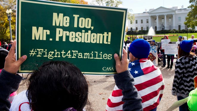 People rally for ceasing deportation of parents who are in the USA illegally on Nov. 7.
