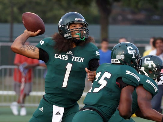 Jayru Campbell looks for an open receiver during first-half action against Southfield at the Prep Kickoff Classic at Wayne State on Aug. 30, 2013.