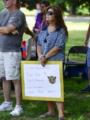 Donna Rose Ezekiel stands and listens during a rally in support of the Emma Sansom monument in Gadsden on Saturday.
