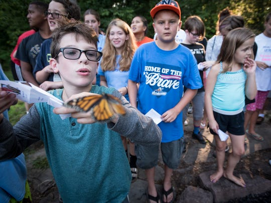 """Camp Kirchenwald in Lebanon County, just minutes from Hershey Medical Center, is the home to Camp Lionheart. Twenty-four children, ages 12 to 18, all victims of heart disease, come to the weeklong camp to enjoy the summer camp experience. On Aug. 2, the campers came together to release monarch butterflies and celebrate the the life of Eleanor """"Ellie"""" Ayers.  Malcolm Ayers, 12, brother to Ellie Ayers, who died at 8 months, in April 2012, from heart disease, releases a Monarch butterfly on Aug. 2, Ellie's birthday."""