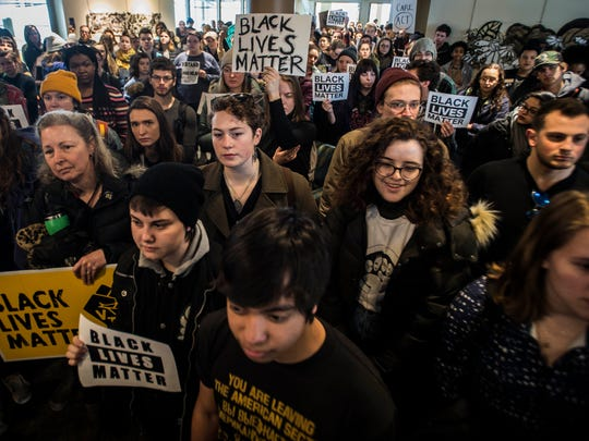 Hundreds of student protesters packed the top floor of the Davis Center listen to University of Vermont staff member John Mejia announce the end to a seven day hunger strike in support of students of color on campus on Friday, Feb. 23, 2018.