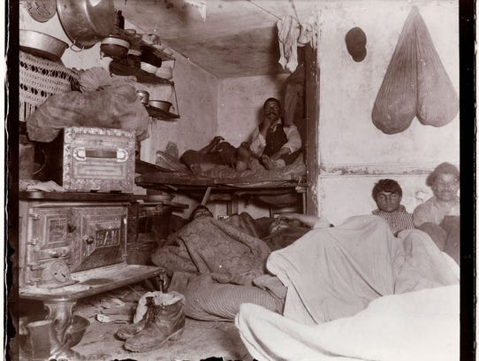 """This photo by Jacob A. Riis, titled """"Five Cents a Spot,"""""""