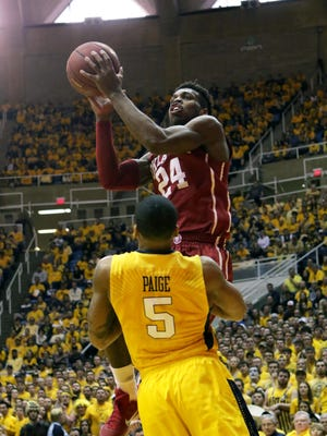 Oklahoma guard Buddy Hield (24) was voted as the winner of the Oscar Robertson Trophy, which goes to the nation's top nation's top college player. MSU's Denzel Valentine was runner-up in the voting.