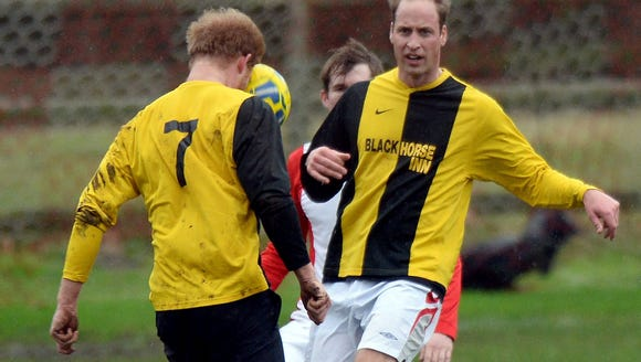 Prince Harry and Prince William play soccer at their
