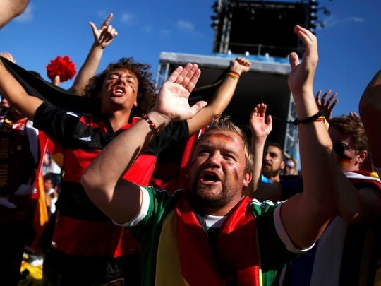 German fans chant slogans as they arrive at Copacabana beach ahead of the 2014 World Cup final match against Argentina in Rio de Janeiro July 13, 2014.