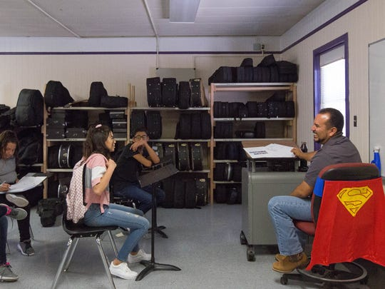 Rene Salazar, right, the mariachi instructor at La Academia Dolores Huerta, jokes with his students as he starts class, Thursday August 16, 2018 at the schools new location in Mesilla Park.